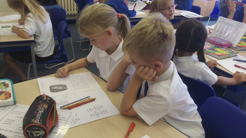 Year 4 children proof-reading their writing