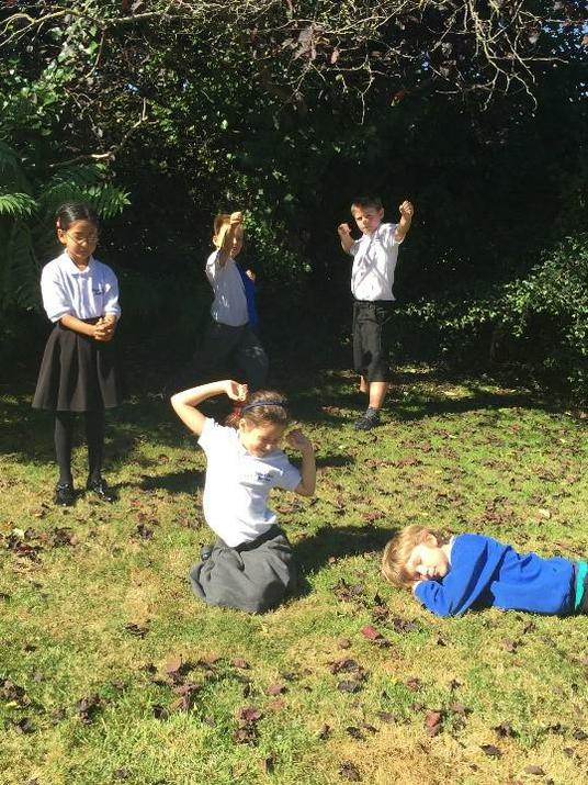 Year 4 pupils freeze-framing a scene from a story