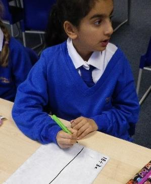 Photo of pupil at a desk