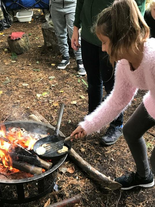 Photo of pupil around the firepit
