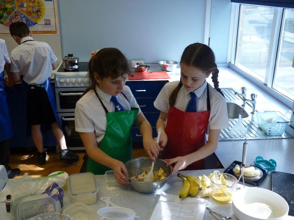 Photo showing pupils baking