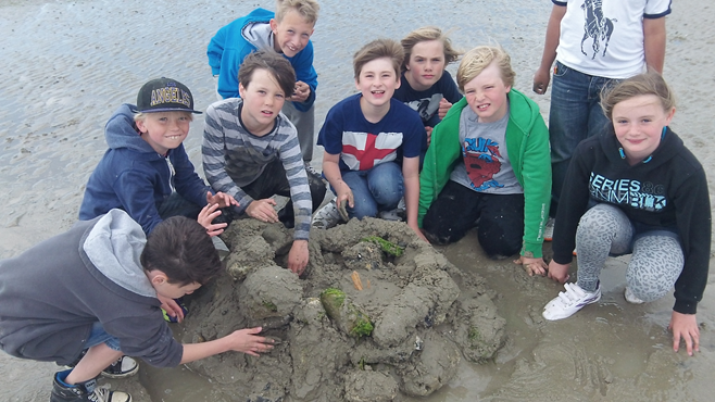 Photo of pupils on the beach
