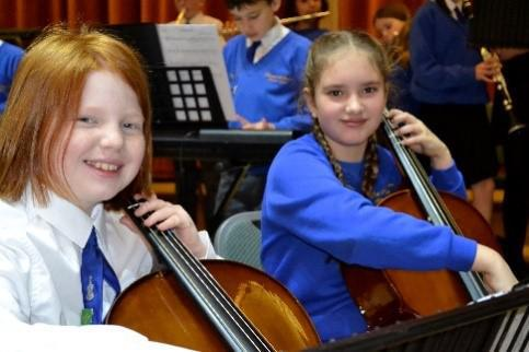 Photo of pupils playing the cello