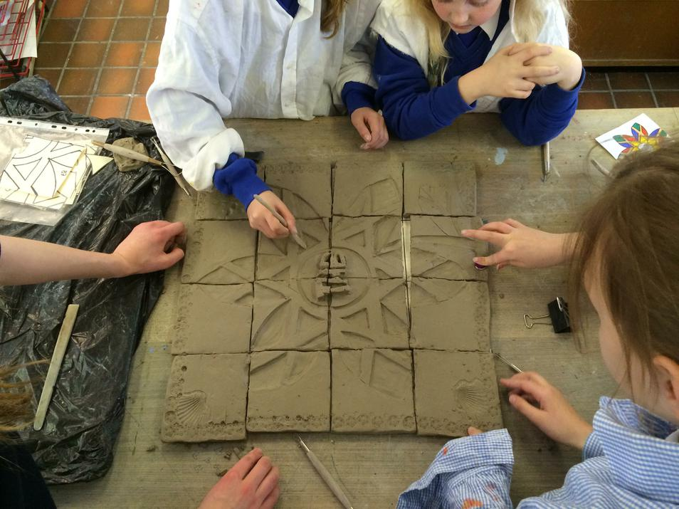 Photo of pupils working with clay