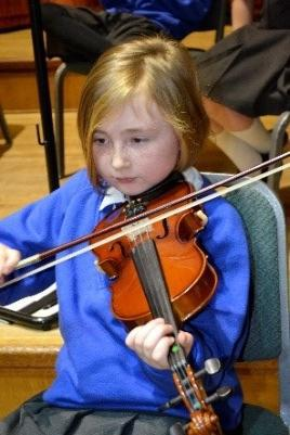 Photo of pupil playing a violin