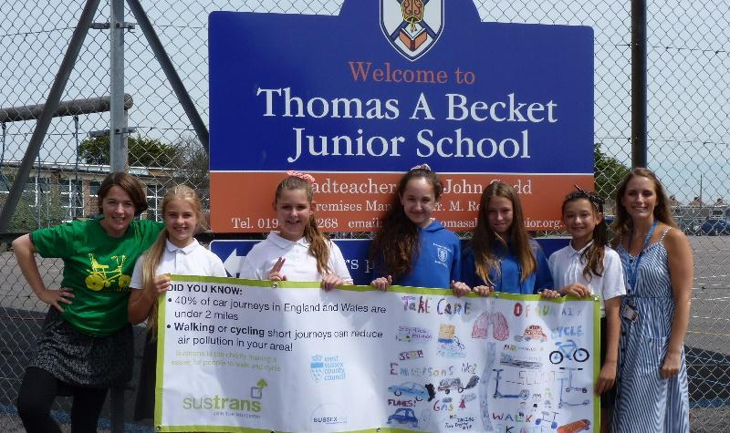 Photo of pupils holding air quality banner