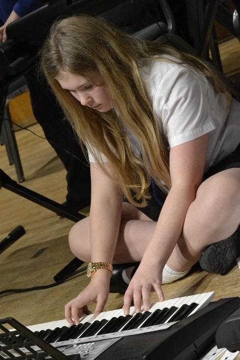 Photo of pupil playing the keyboard