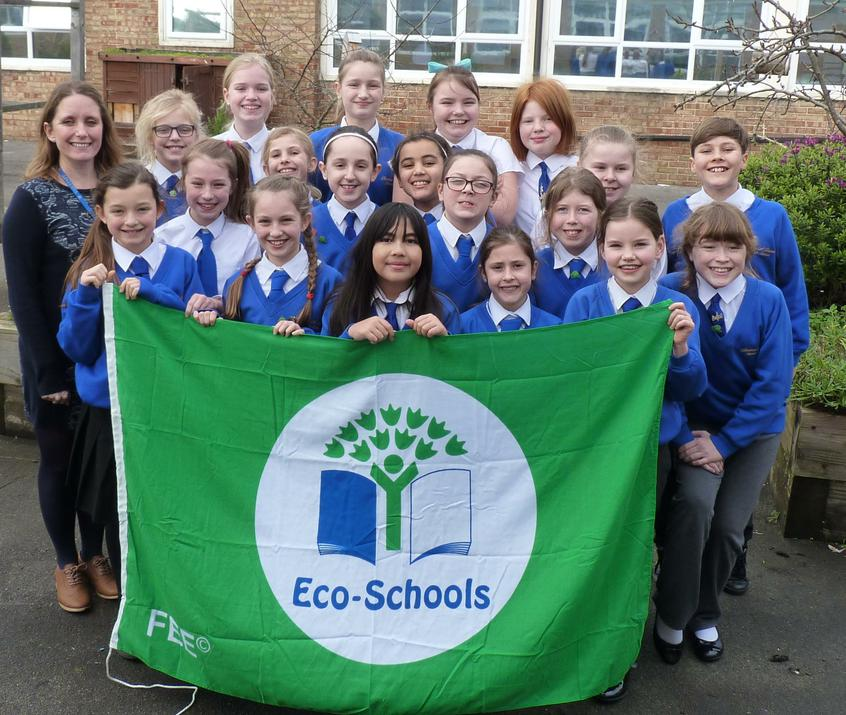 Photo of pupils with Eco Schools Flas