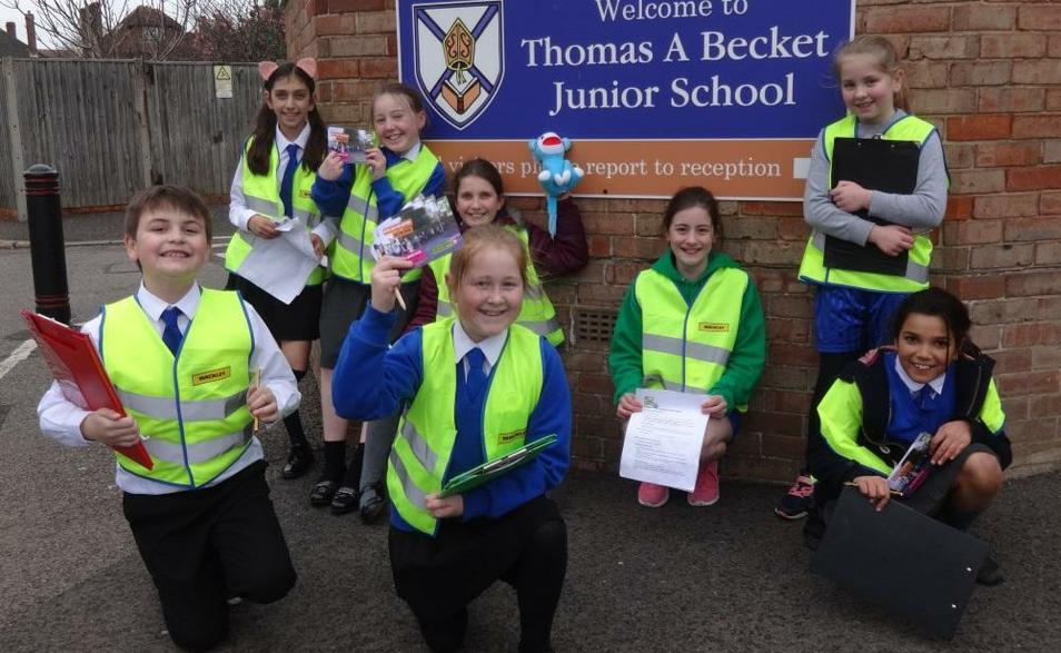 Photo of pupils conducting survey about Air Quality outside of the school building