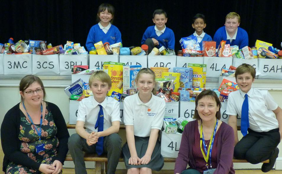 Photo showing pupils with charity donations