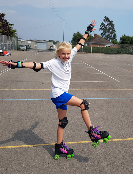 Photography of pupil wearing rollerskates on the playground