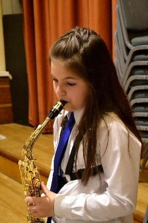 Photo of pupil playing saxophone