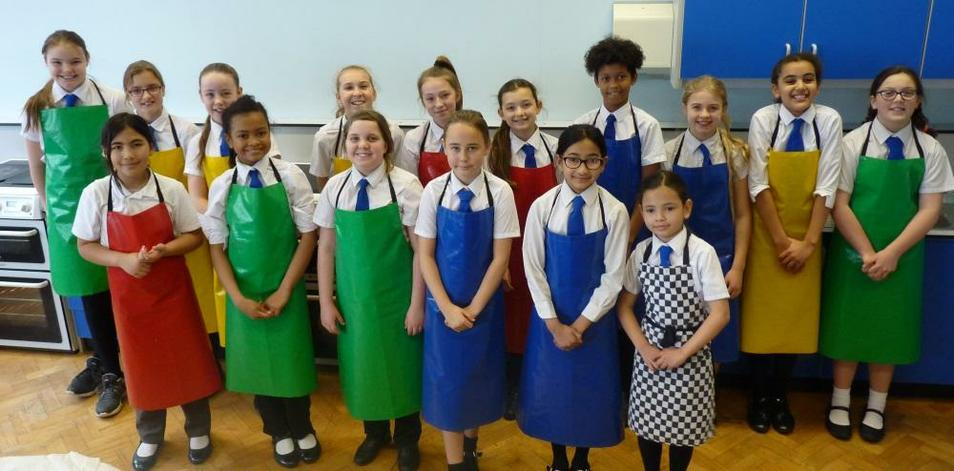 Photo of pupils taking part in baking competition
