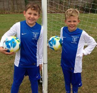 Photo of pupils holding fairtrade footballs