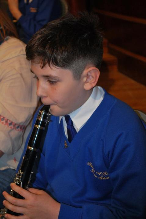 Photo of pupil playing the clarinet