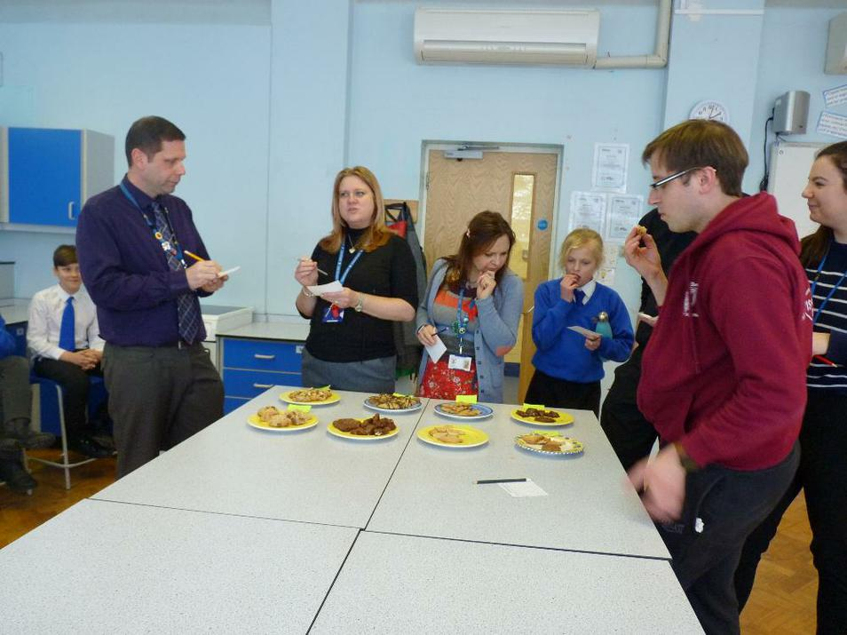 Photo of staff and visitors judging baking competition