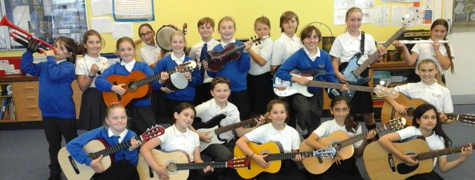 Photo of pupils with musical instruments