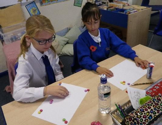 Photo of pupils sitting at a desk