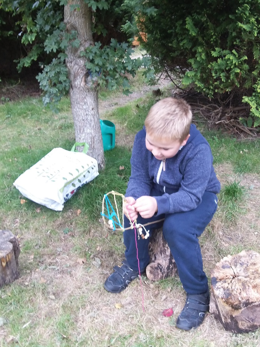 Photo of pupil in the forest school area