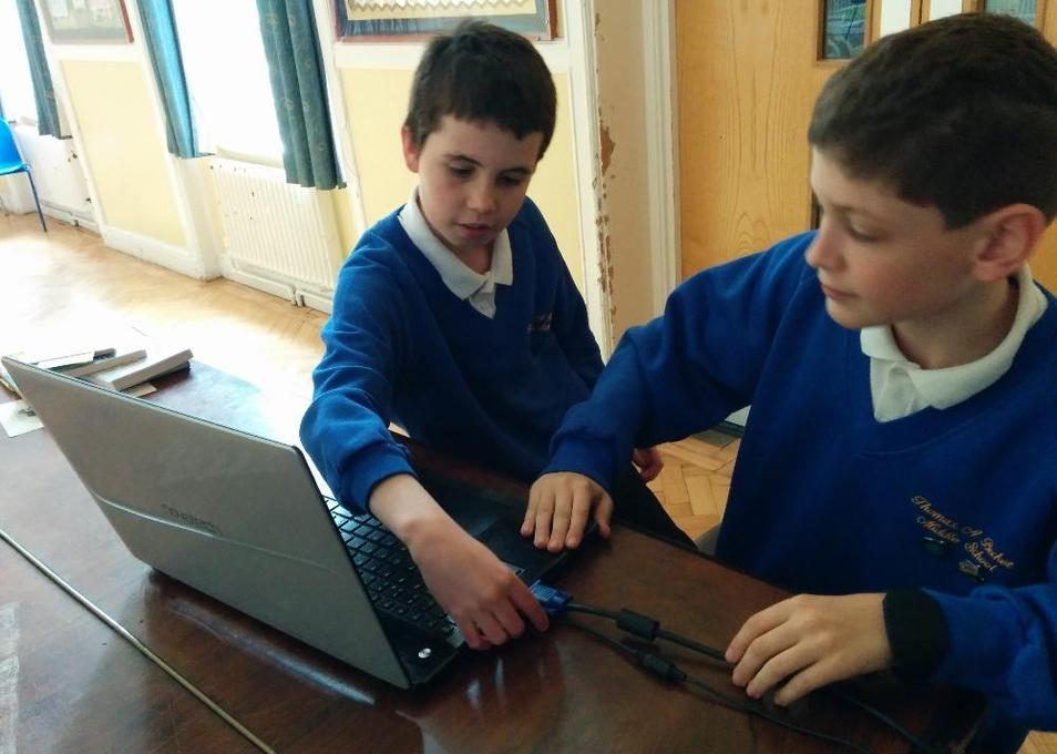Photo of pupils using a laptop