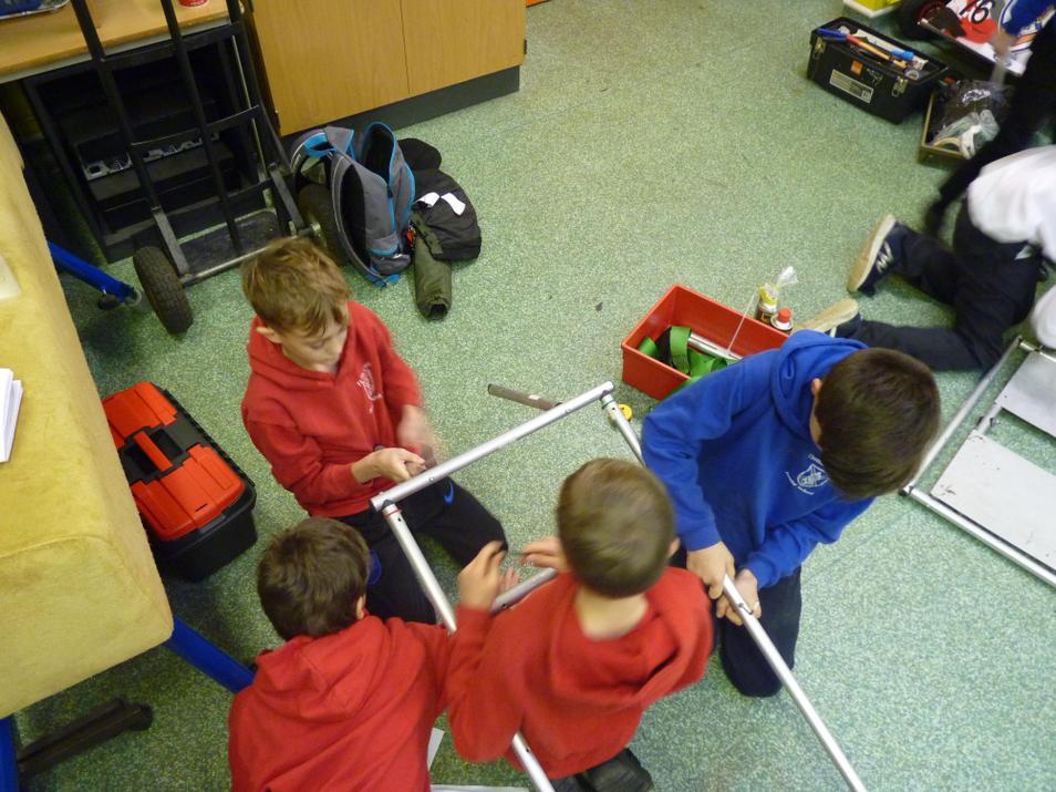 Photo of pupils building Formula Goblin Go kart