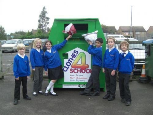 Photo of pupils outside clothes donation bin