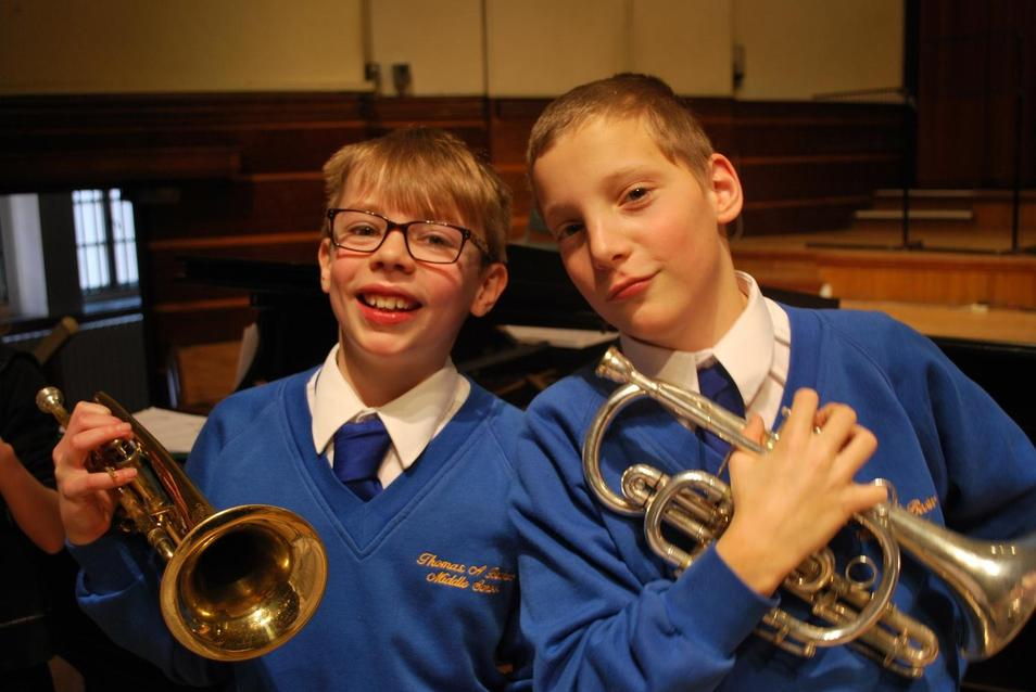 Photo of two pupils with trumpets