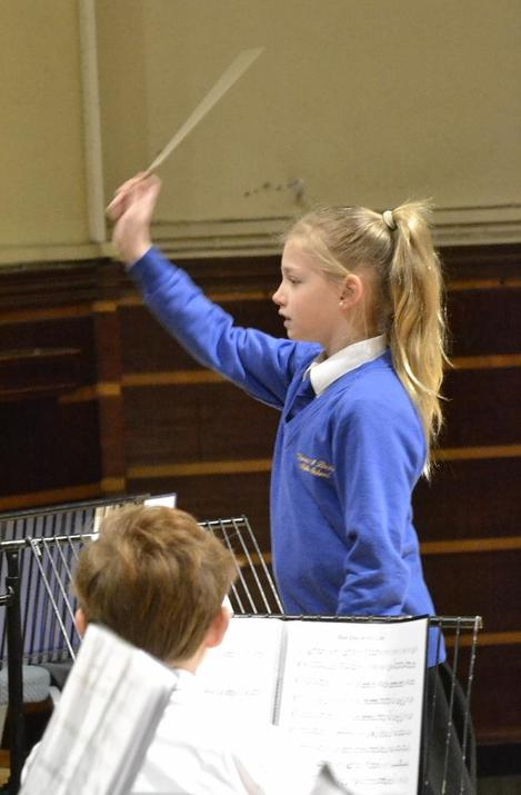 Photo of pupil conducting the orchestra