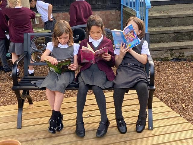 Year 3 pupils reading in our new garden