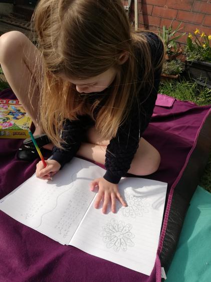 Enjoying the sunshine whilst learning