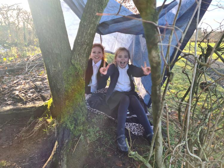Tarp and rope den building