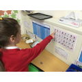 We practise our reading through a multi sensory approach in continuous provision.