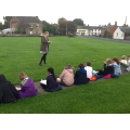 We sat on the green to learn about the old school.