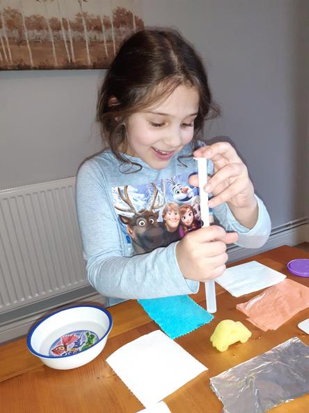 Busy carrying out her science work.