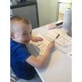 Logan working hard with his phonics