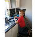 Charlie R washing up