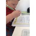 Kylan working hard on his writing