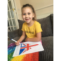 Erin colouring her VE day bunting