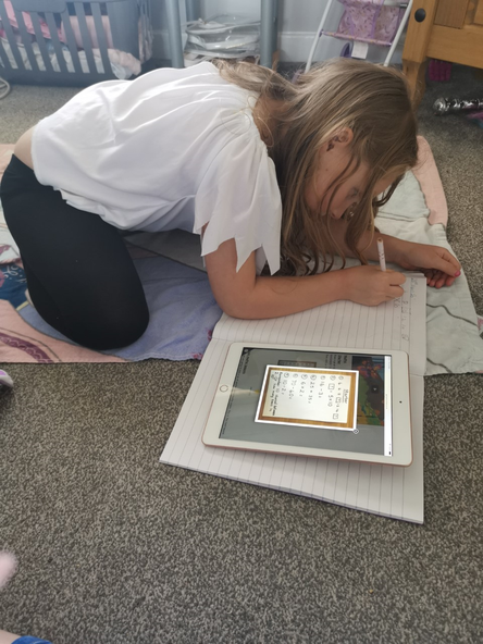 Great concentration doing her maths work!