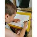 Wenny working hard, writing very neatly