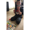 Charlie and his Mummy playing monopoly
