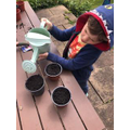 Billy watering his plants