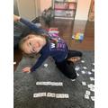 Isabelle practising how to spell her full name