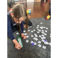 Isabelle practising spelling tricky words