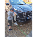 Charlie T helping Daddy wash the car