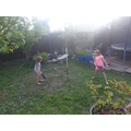 Playing swing ball in the garden.