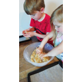 Blake and his sister making oaty biscuits