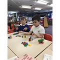 Krystian and Frankie working hard in school