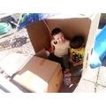 Joshua made a den out of a box and it has a TV!