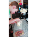 Blak making chocolate apples...YUM!